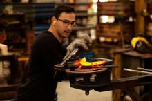 Blacksmith Bending Hot Metal I...