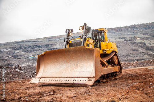 Fotomural yellow bulldozer at construction site