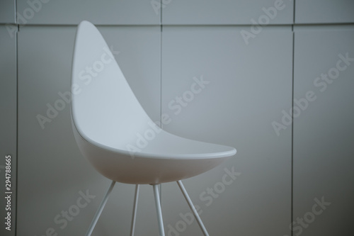 White chair on a simple background. office and business concept. Canvas Print