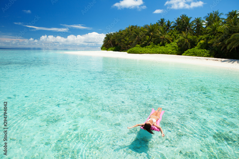 Fototapety, obrazy: Woman swim and relax in the sea. Happy island lifestyle. White sand, crystal-blue sea of tropical beach. Vacation at Paradise. Ocean beach relax, travel to Maldives islands