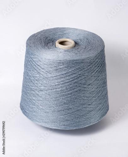 bobbin of yarn on a white background Canvas Print