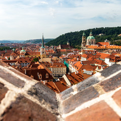Fototapeta na wymiar View on Prague panorama with red roofs and historic architecture