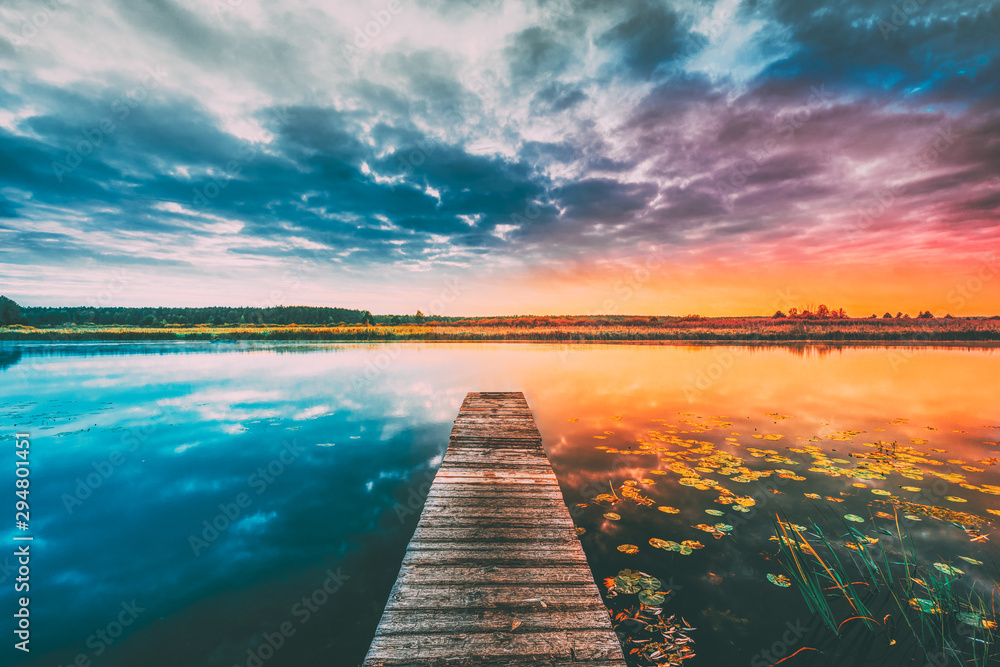 Fototapety, obrazy: Landscape With Wooden Boards Pier On Calm Water Of Lake, River At Sunset Time, Forest On Other Side. Summer To Autumn Season Transition Concept In Nature