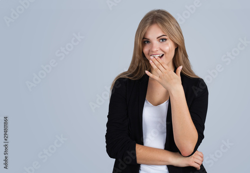 Young blonde woman amazed, copyspace, isolated on grey Wallpaper Mural