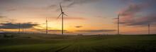 Windmills On A Field In German...