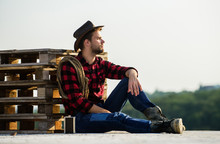 Farmer Enjoy View From His Farm. Romanticism Of Western Culture. Farmer In Hat Sit Relax. Peaceful Mood. Watching Sunset. Farmer Cowboy Handsome Man Relaxing After Hard Working Day At Ranch