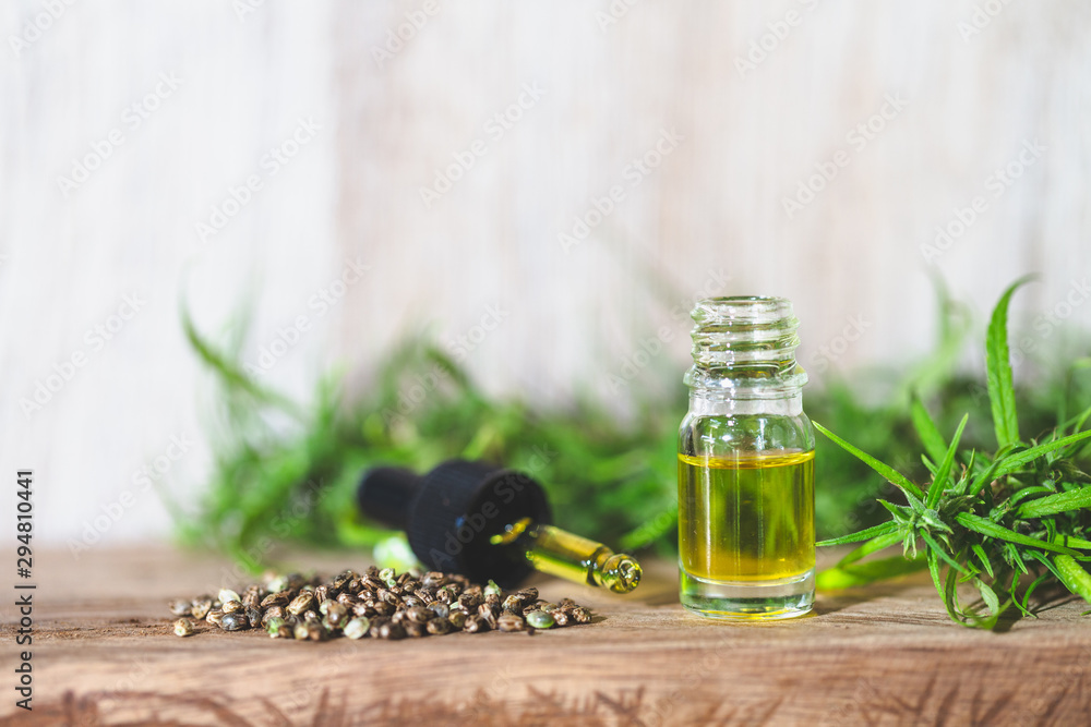 Fototapety, obrazy: CBD oil hemp products, Medicinal cannabis with extract oil in a bottle. Medical cannabis concept