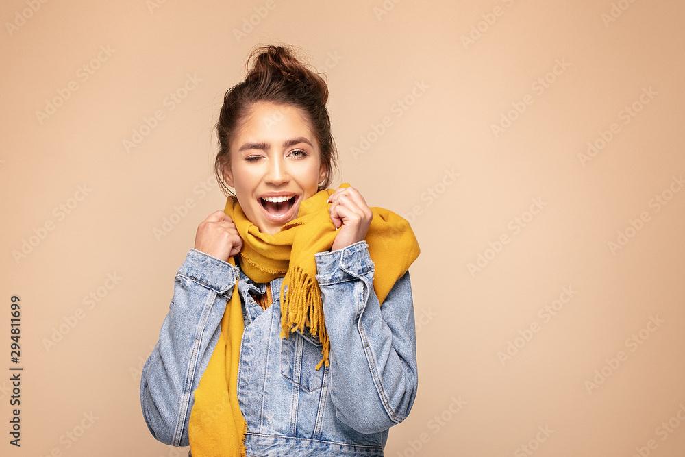 Fototapeta Happy girl in autumn yellow scarf.