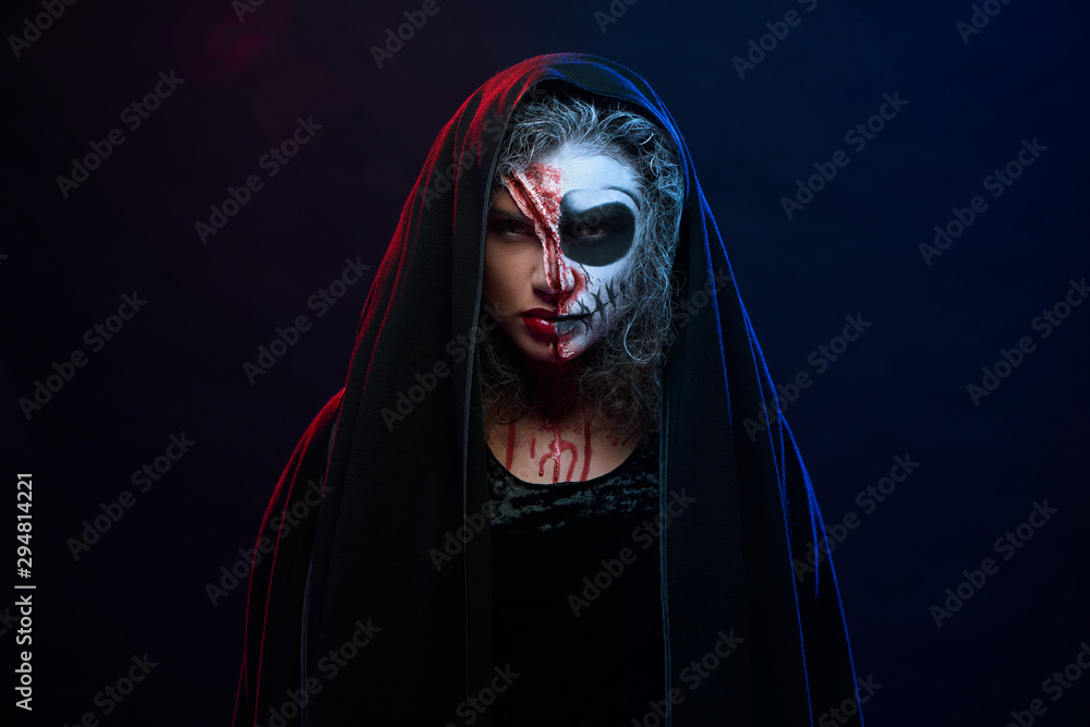 Fototapety, obrazy: Attractive woman in halloween costume with skeleton makeup