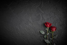 Red Roses Are Placed On A Blac...