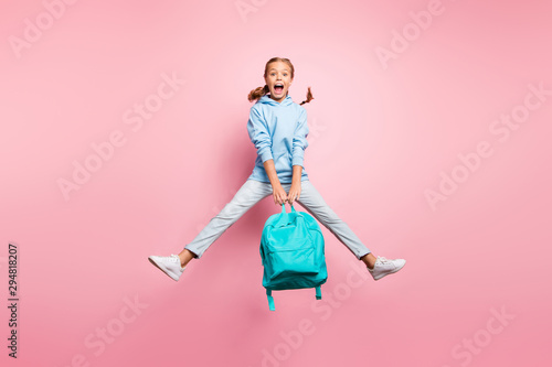 Obraz Summer. Full size photo of pretty little lady jumping high enjoy last studying day wear teal pupil backpack casual sweater clothes isolated pink color background - fototapety do salonu