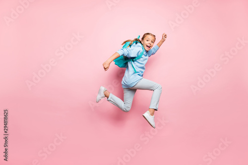 Poster Hoogte schaal Full length body size photo of cheerful excited crazy positive girl running fast with rucksack behind her back wearing blue sweater jeans denim isolated over pink pastel color background