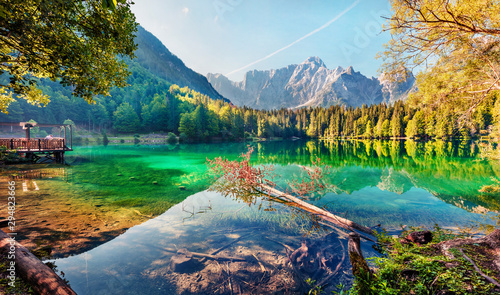 Obraz Colorful summer view of Fusine lake. Bright morning scene of Julian Alps with Mangart peak on background, Province of Udine, Italy, Europe. Traveling concept background. - fototapety do salonu