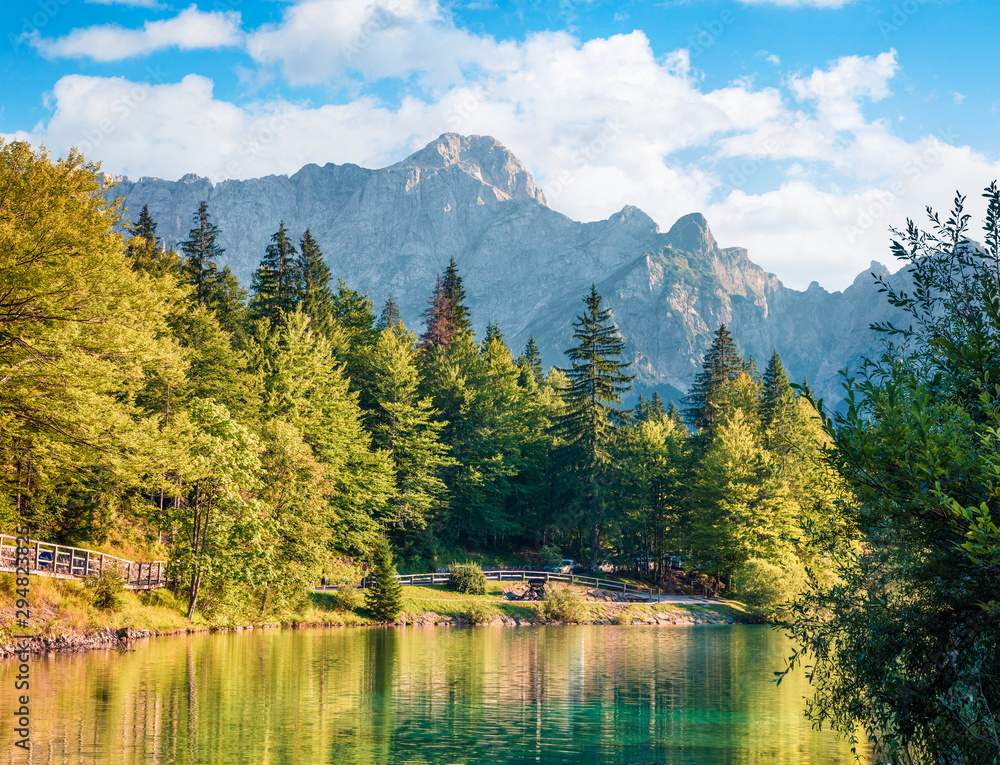 Fototapety, obrazy: Sunny morning view of Fusine lake. Colorful summer scene of Julian Alps with Mangart peak on background, Province of Udine, Italy, Europe. Traveling concept background.