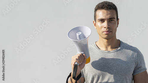 Man ready for demonstration with megaphone Wallpaper Mural