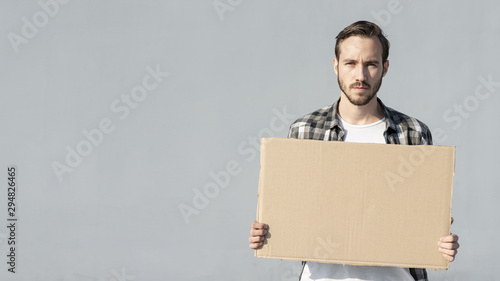 Young man holding board with mock-up Canvas Print