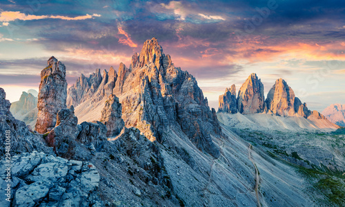 Unbelievable morning view of Paternkofel and Tre Cime Di Lavaredo mpountain peaks. Wonderful summer sunset in Dolomiti Alps, South Tyrol, Italy, Europe. Beauty of nature concept background.
