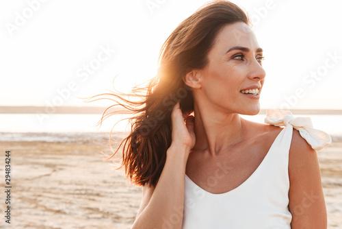 Obraz Close up of a beautiful young woman wearing summer dress - fototapety do salonu