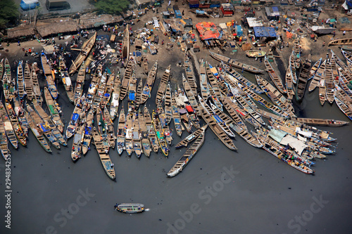 Unloading the catch of the day from fishing boats in Accra, Ghana Wallpaper Mural