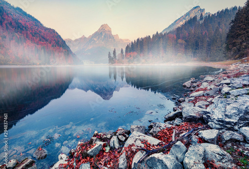 Fototapeta Great autumn sunrise on Obersee lake, Nafels village location. Perfect morning scene of Swiss Alps, canton of Glarus in Switzerland, Europe. Beauty of nature concept background. obraz