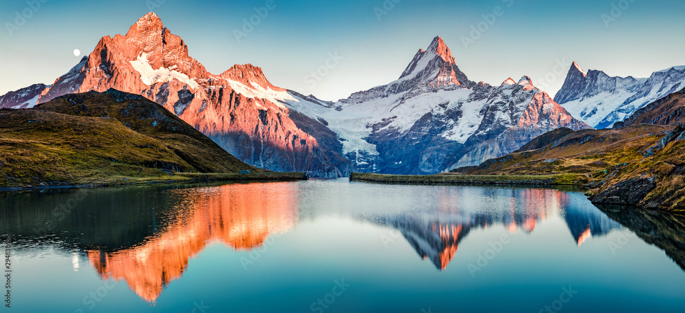 Fototapeta Fantastic evening panorama of Bachalp lake / Bachalpsee, Switzerland. Picturesque autumn sunset in Swiss alps, Grindelwald, Bernese Oberland, Europe. Beauty of nature concept background..