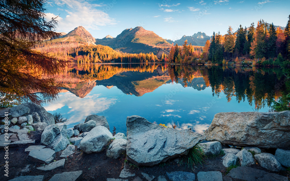 Fototapeta Attractive autumn view of Strbske pleso lake. Calm morning scene of High Tatras National Park, Slovakia, Europe. Beauty of nature concept background.