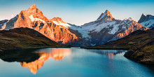 Breathtaking Evening Panorama Of Bachalp Lake/Bachalpsee, Switzerland. Exciting Autumn Sunset In Swiss Alps, Grindelwald, Bernese Oberland, Europe. Beauty Of Nature Concept Background.