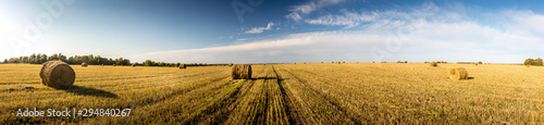 Fototapeta Haystacks on the field in autumn season with cloudy sky. obraz