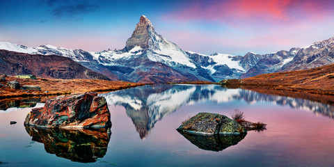 Fototapeta Krajobraz Panoramic morning view of Stellisee lake with Matterhorn / Cervino peak on background. Impressive autumn scene of Swiss Alps, Zermatt resort location, Switzerland, Europe.