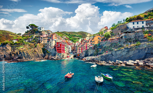 Foto auf Gartenposter Ligurien Sunny summer view of Riomaggiore - Cique Terre sequence of hill cities. Wonderful morning view of Liguria, Italy, Europe. Splendid spring seascape of Mediterranean sea. Traveling concept background.