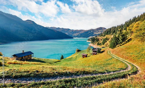 Fotobehang Herfst Sunny morning view of Roselend lake/Lac de Roselend. Bright autumn scene of Auvergne-Rhone-Alpes, France, Europe. Beauty of nature concept background.