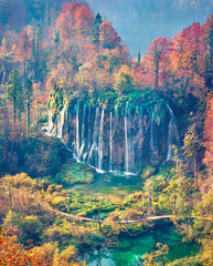 Panel Szklany Wodospad Epic morning view of pure water waterfall in Plitvice National Park. Aerial autumn scene of Croatia, Europe. Abandoned places of Plitvice lakes series. Beauty of nature concept background.