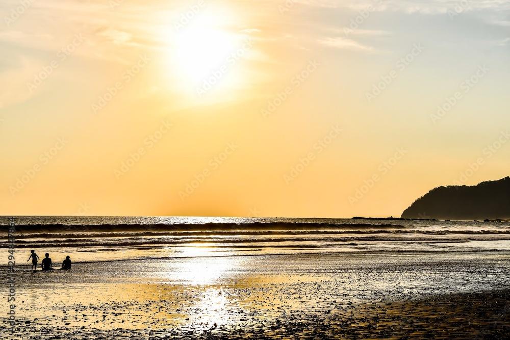 Fototapeta sunset on beach, in Jaco costa rica central america