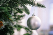 canvas print picture - Christmas tree branch decorated with silver balls and white decor