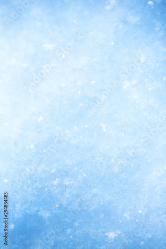 Tuinposter Lichtblauw Winter christmas background. Snowflakes in the soft white snow. Winter background.