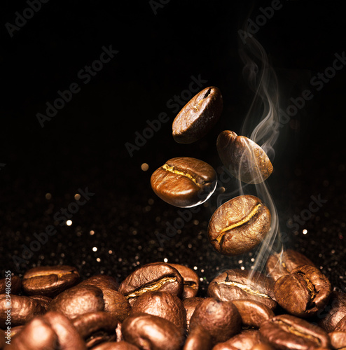Keuken foto achterwand Cafe Roasted coffee beans. Seeds of freshly roasted coffee with smoke. Coffee beans closeup with emphasis on the grain with smoke.