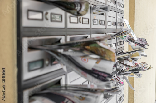 Mail boxes filled of leaflets Canvas Print