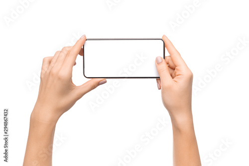 Canvastavla  Female hands taking photo on smartphone with blank screen