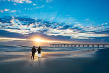 Couple Walking On Beach At Sun...