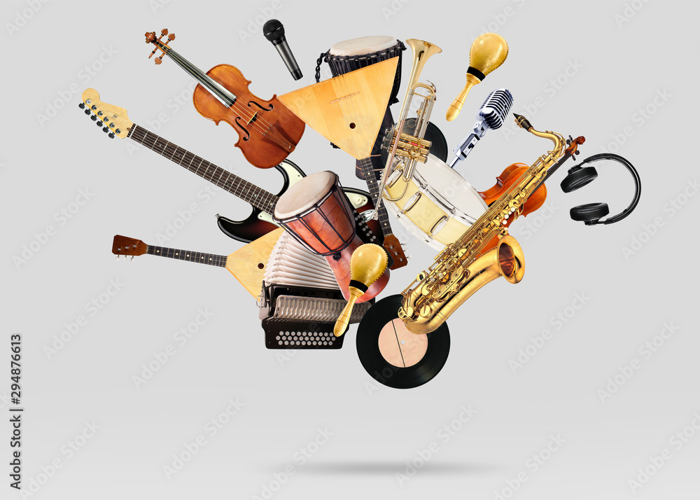 Fototapety, obrazy: A variety of musical instruments in beautiful flight