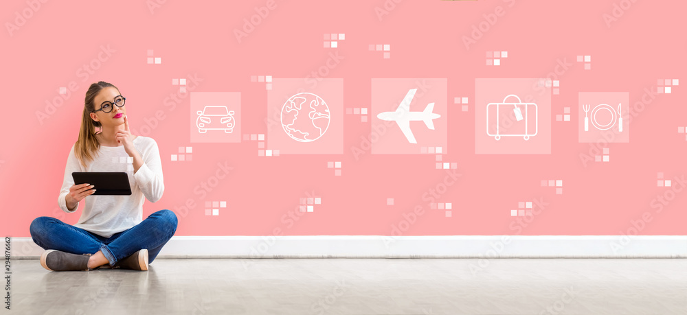 Fototapeta Airplane travel theme with young woman holding a tablet computer