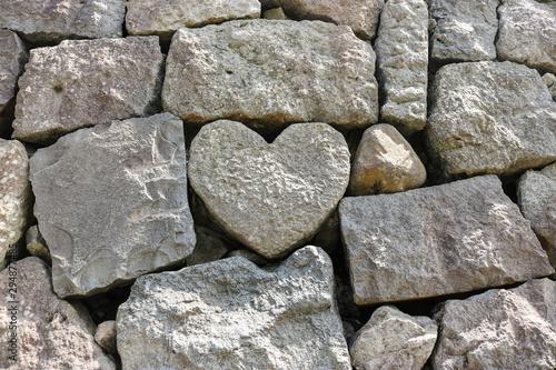 The heart-shaped rock on wall stone at Meganebashi Brigde in Nagasaki, Japan