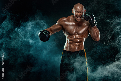 Photo  Sportsman, man boxer fighting in gloves on black background