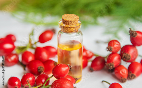 Rosehip seed essential oil in a small bottle. Selective focus. Canvas
