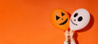 canvas print picture - Halloween orange background with creative ghost and pumpkin