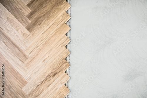 wooden floor background - herringbone parquet background with glue and stone und Canvas Print
