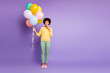 Leinwanddruck Bild - Omg i share secret. Full length photo of amazed mulatto girl close mouth palm hold baloons tell news friends birthday celebration party wear green yellow outfit isolated violet color background