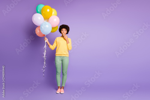 Spoed Foto op Canvas Dinosaurs Omg i share secret. Full length photo of amazed mulatto girl close mouth palm hold baloons tell news friends birthday celebration party wear green yellow outfit isolated violet color background