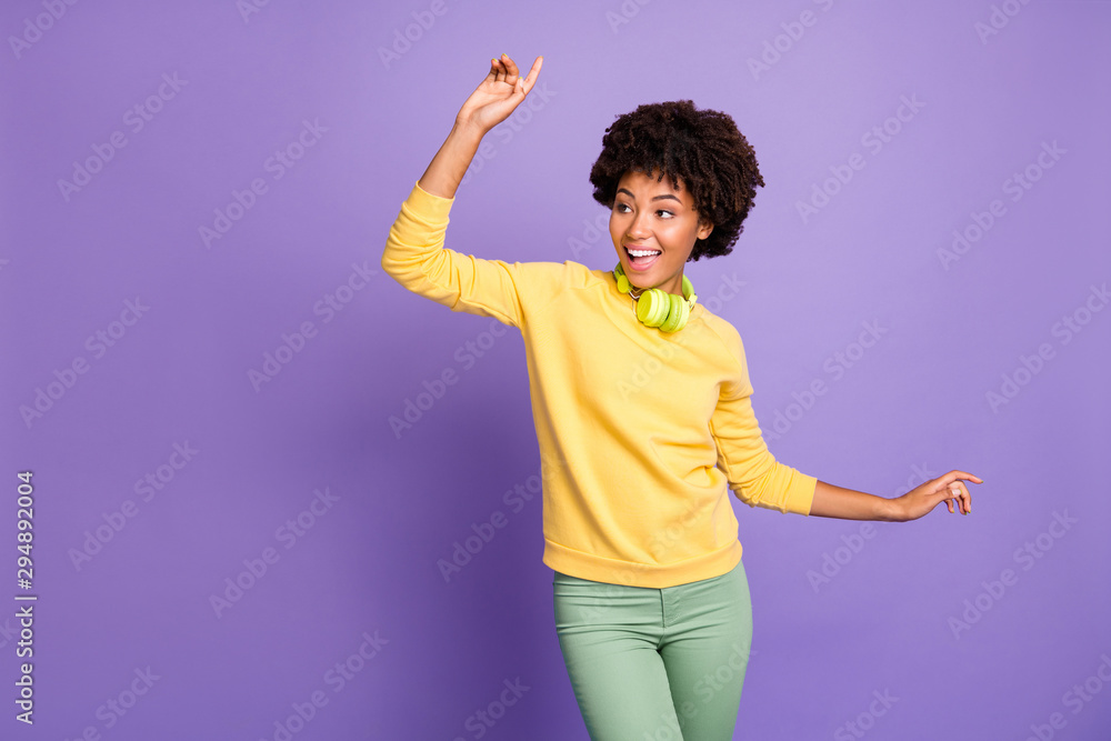 Fototapety, obrazy: Photo of curly wavy cheerful positive cute nice sweet dancing youngster moving with earphones around her neck wearing green pants trousers isolated over purple pastel color background