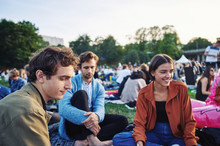 Friends Sitting Together In Park